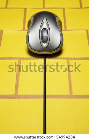 Computer mouse on note paper - stock photo