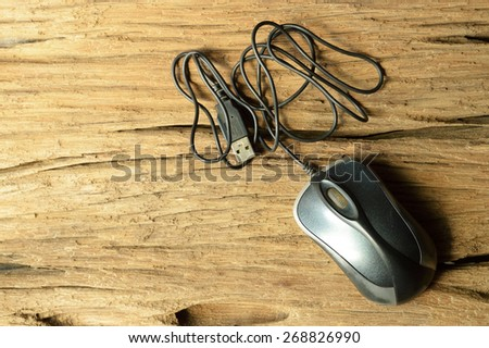 computer mouse on old wooden table