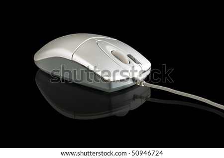 computer mouse on the black