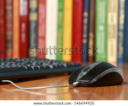 Computer mouse on the desk - stock photo