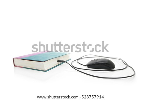 Computer mouse plugged into a book, on white. Online learning or Internet research concept