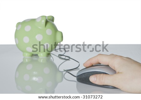 Computer mouse with hand and piggy bank - stock photo
