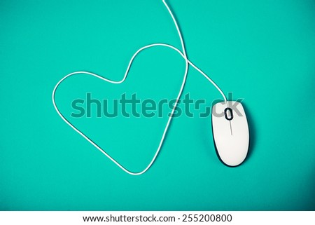 computer mouse with heart shaped cord - stock photo