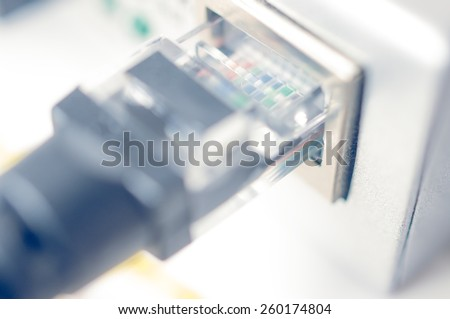 Computer network cable, Rj45 connector. Blurred photo - stock photo