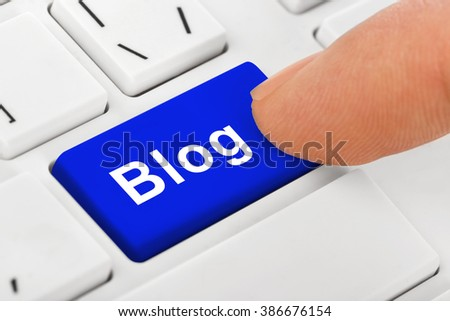 Computer notebook keyboard with Blog key - technology background - stock photo