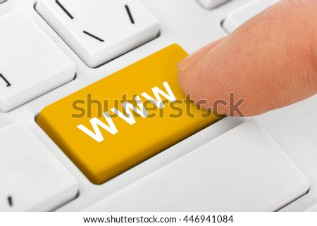 Computer notebook keyboard with Internet key - technology background - stock photo