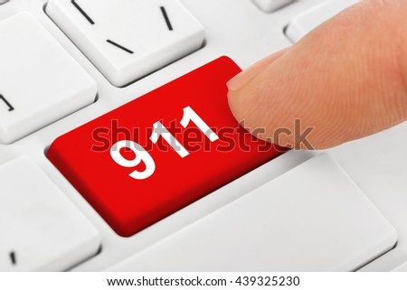 Computer notebook keyboard with 911 key - stock photo