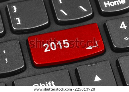 Computer notebook keyboard with 2015 key - holiday technology concept