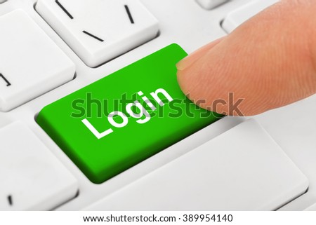 Computer notebook keyboard with Login key - technology background