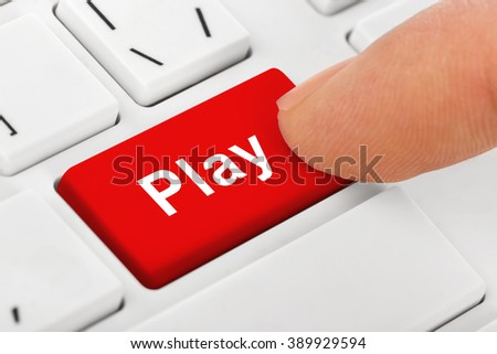 Computer notebook keyboard with Play key - technology background - stock photo