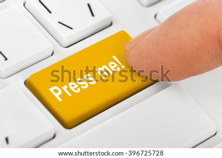 Computer notebook keyboard with Press me key - technology background - stock photo