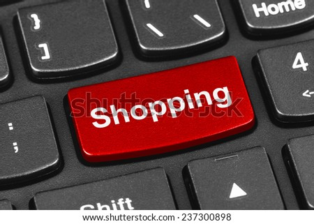 Computer notebook keyboard with Shopping key - technology background - stock photo