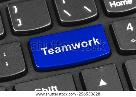 Computer notebook keyboard with Teamwork key - technology background - stock photo