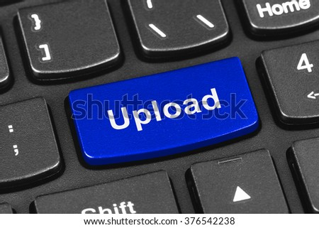 Computer notebook keyboard with Upload key - technology background - stock photo