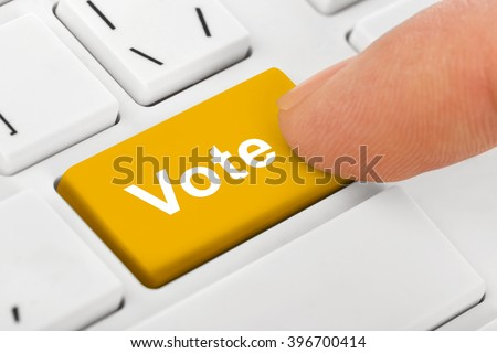 Computer notebook keyboard with Vote key - technology background - stock photo