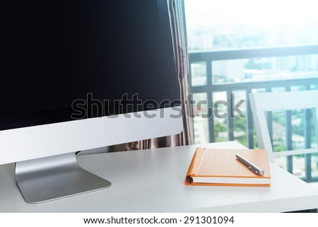 Computer on Home Office with phone and notebook - stock photo