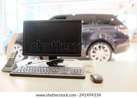 computer on the desktop in showroom - stock photo