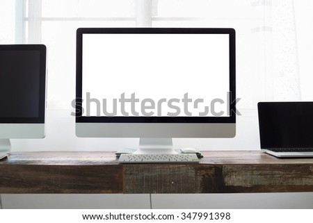 computer on wooden table work business office, white blank display screen monitor - stock photo