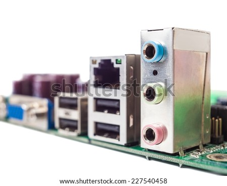 Computer parts are installed on board closeup - stock photo