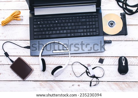 Computer Peripherals & Laptop Accessories. Composition on white wooden board. - stock photo
