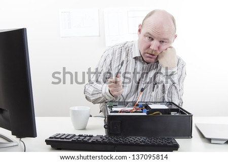 Computer Problems. Office worker / businessman with lose computer cables. - stock photo