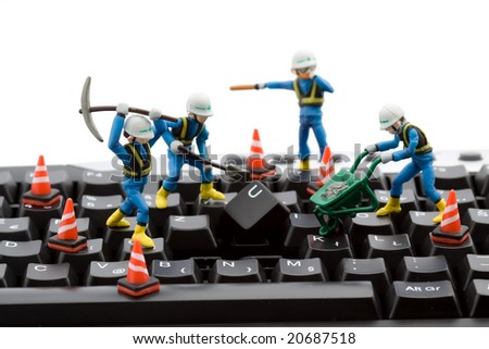computer repair concept - workers repairing keyboard - stock photo
