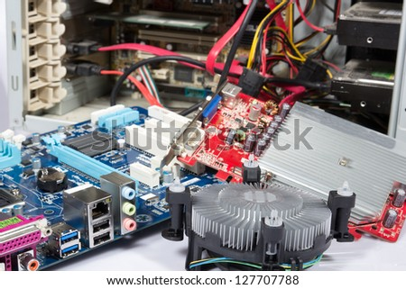 computer repair or upgrade, open pc and parts at it - stock photo