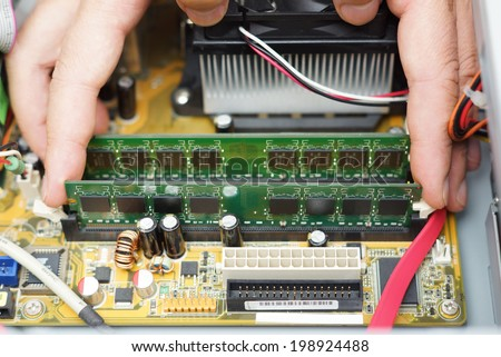 Computer repair.  Technician takes random access memory module out - stock photo