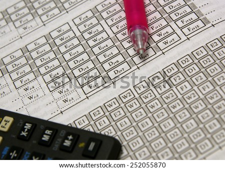 Computer science, computer networks advanced calculations (gates) together with calculator and pink pencil in the background - stock photo