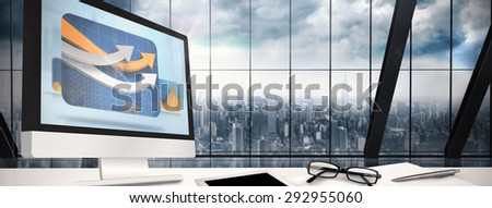 Computer screen against room with large window looking on city - stock photo