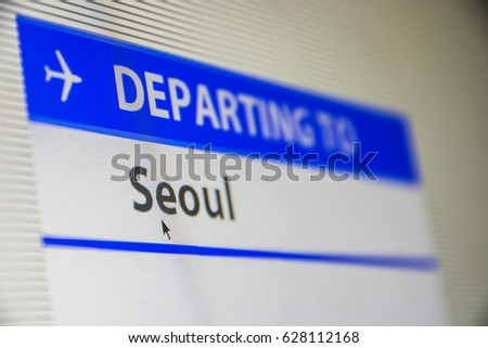Computer screen close-up of status of flight departing to Seoul, South Korea