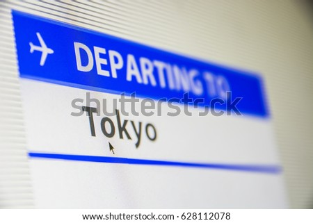 Computer screen close-up of status of flight departing to Tokyo, Japan