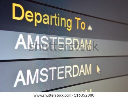 Computer screen closeup of Amsterdam flight status - stock photo