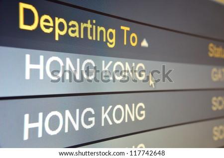 Computer screen closeup of Hong Kong flight status - stock photo