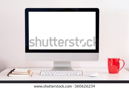 Computer screens isolated stand on a table with red cup  and note book. - stock photo