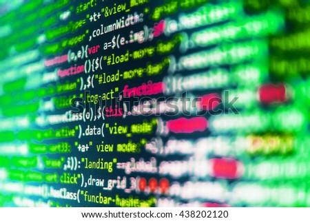 Computer script.  Developer working on program codes in office. Software development. Programming code abstract screen of software developer. Writing programming code on laptop. Computer program.   - stock photo