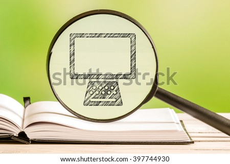 Computer search with a pencil drawing of a personal computer in a magnifying glass - stock photo
