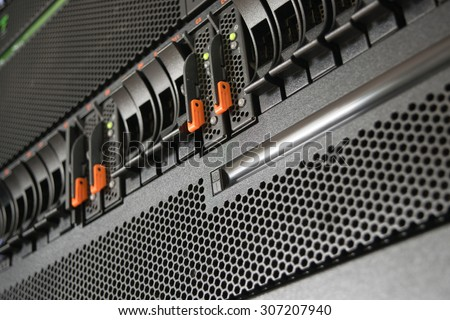 Computer Server and raid storage in datacenter - stock photo