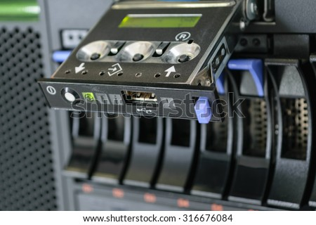 Computer Server with panel and raid storage in datacenter - stock photo