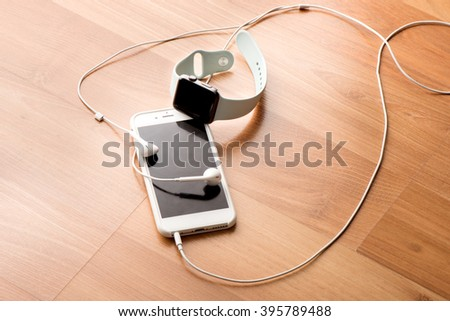 Computer, Smart watch, phone,headphone with wood background