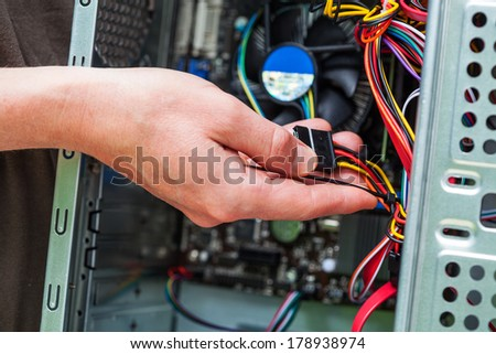 Computer specialist hold cables - stock photo