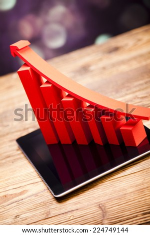 Computer tablet with financial graph  - stock photo