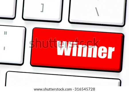 Computer white keyboard with winner