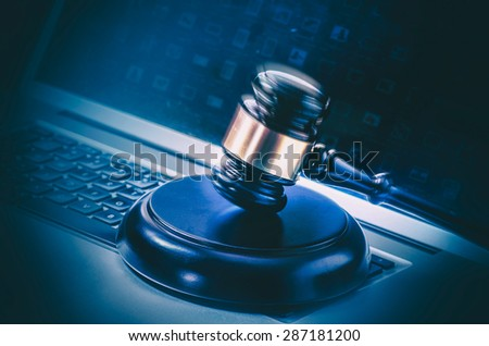 Computer with gavel - stock photo