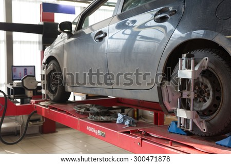 Computerized Laser Wheel Alignment System in Car Garage Service - stock photo