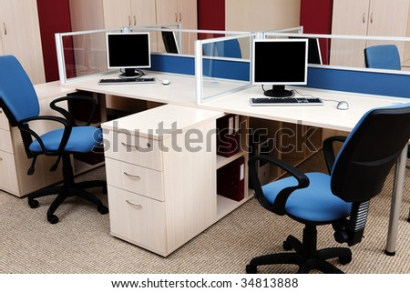 computers behind the glass in a modern office - stock photo