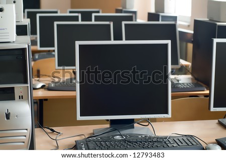 computers in a row in the university class - stock photo