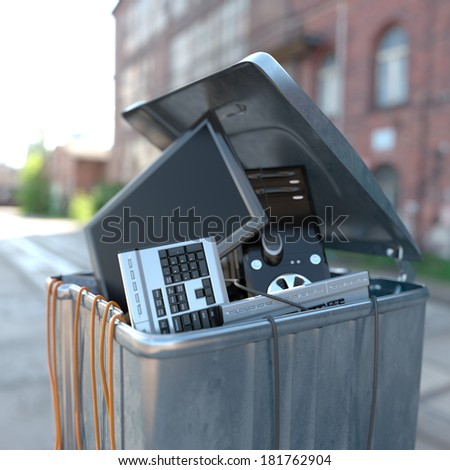 computers in a trash bin on a street - stock photo