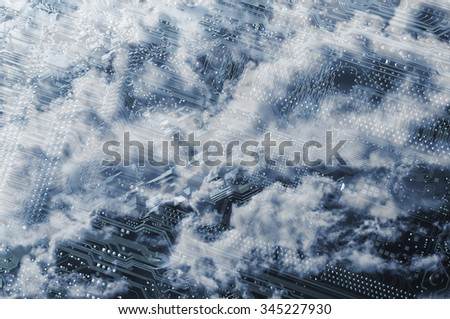 computers motherboard with cloudscape formations above - stock photo