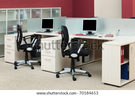 computers on the desks in a modern office